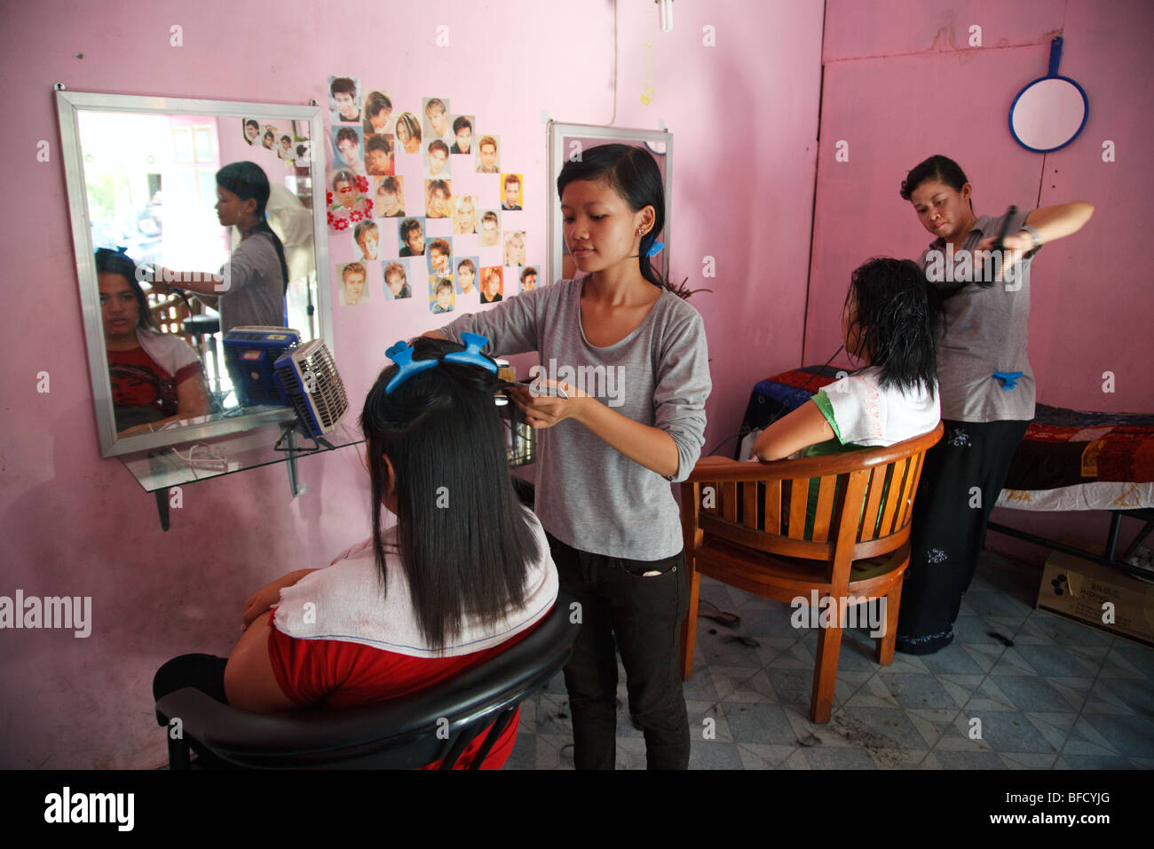 women at the hairdresser salon in Yogyakarta, Indonesia - Stock Image