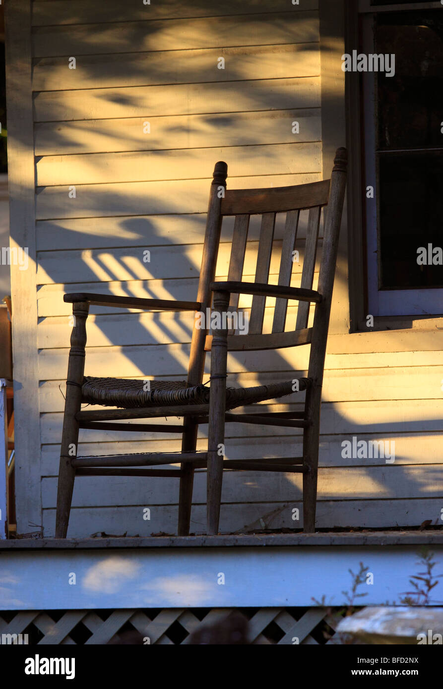 Chair on porch, Long Island, NY - Stock Image
