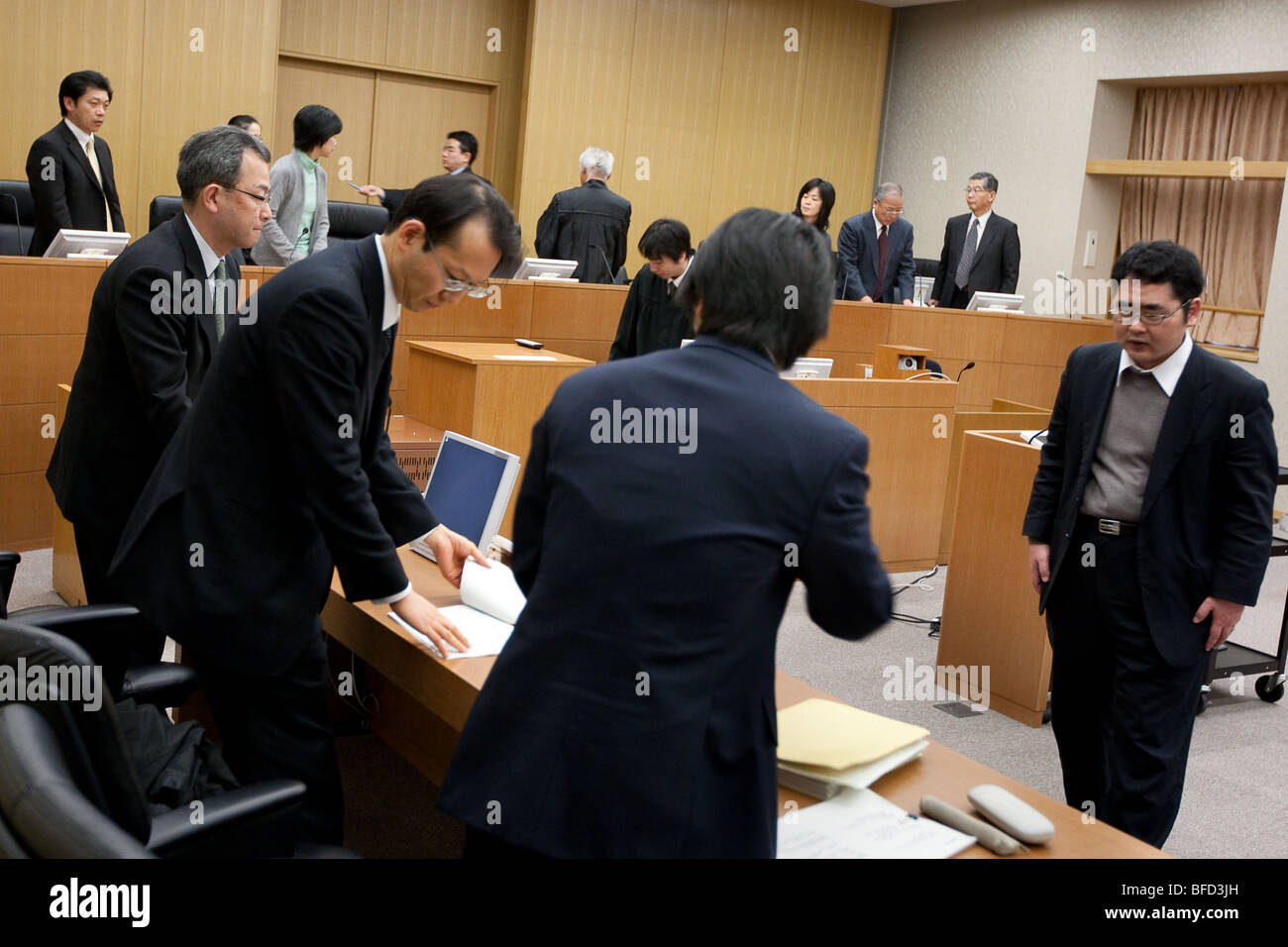 a 'mock' jury/court case being acted out in a Japanese law court. - Stock Image