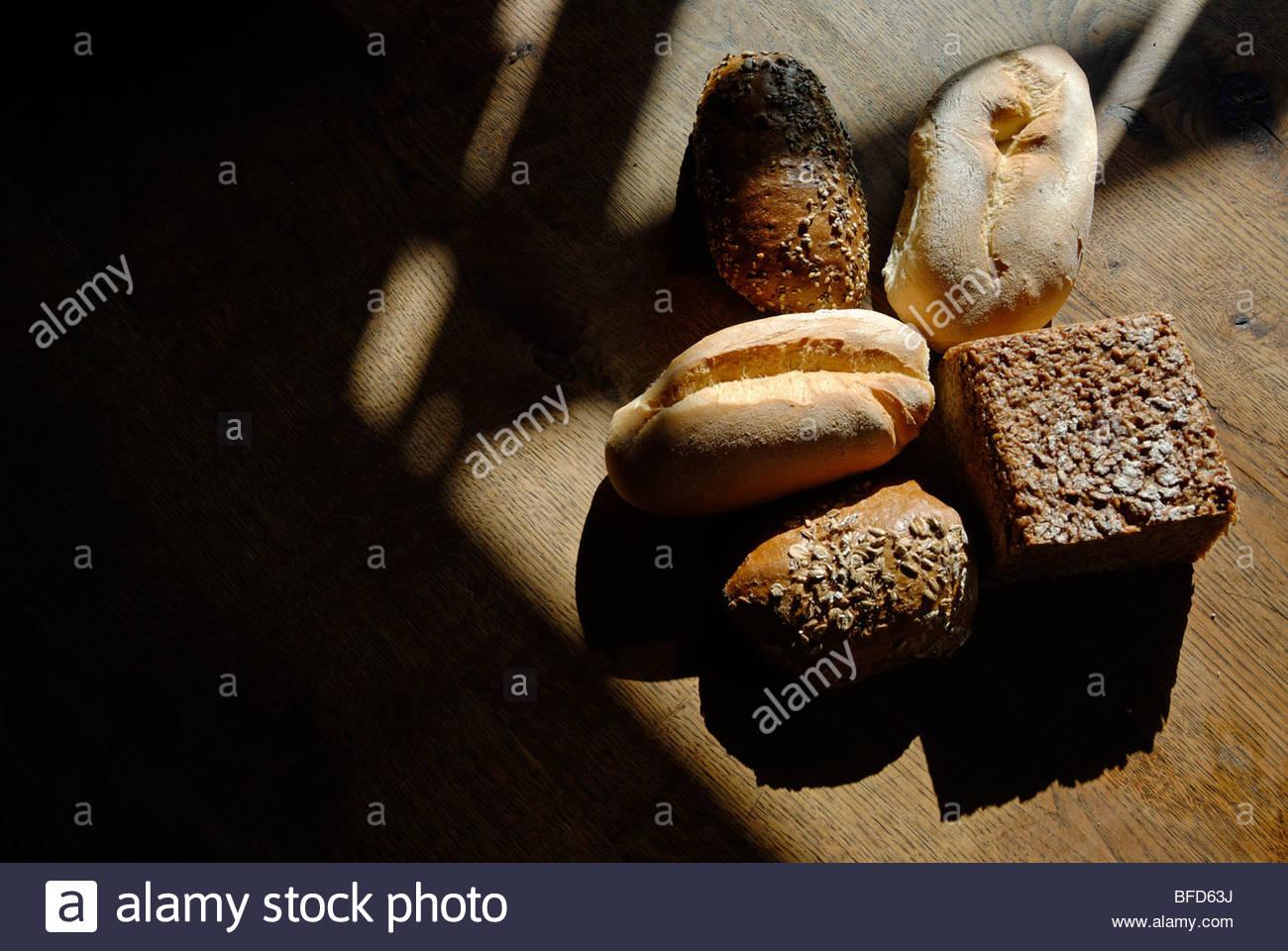selection of German light and dark multigrain rye bread rolls - Stock Image