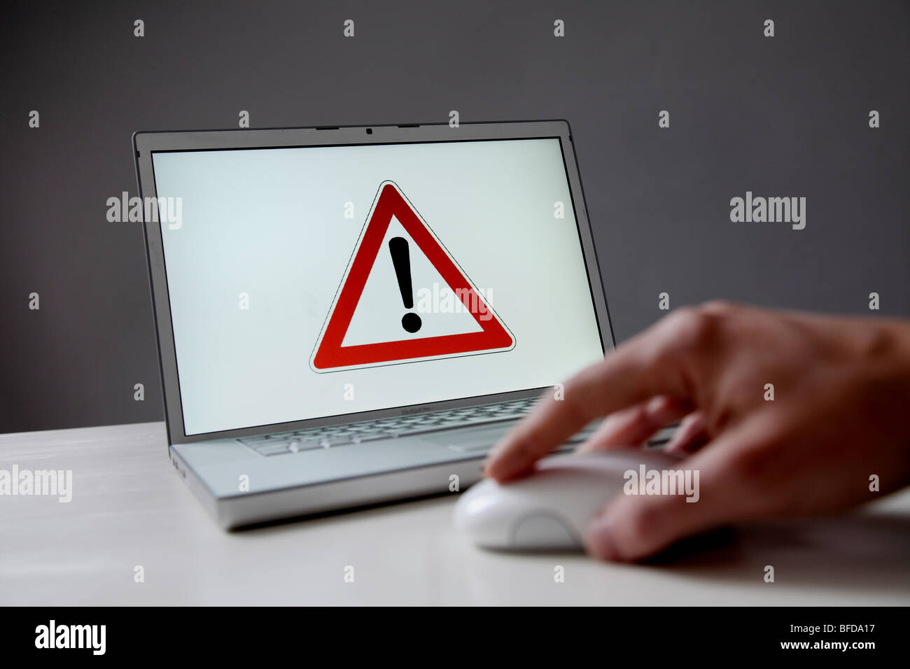 Warning sign on computer screen - Stock Image