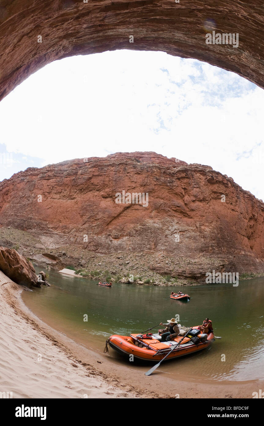 A raft comes to shore on the banks of Colorado River's Grand Canyon. - Stock Image