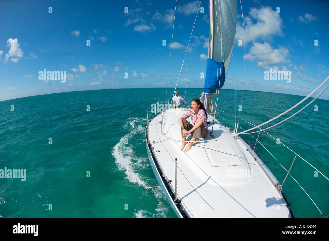 A man and woman sailing off of Florida. - Stock Image