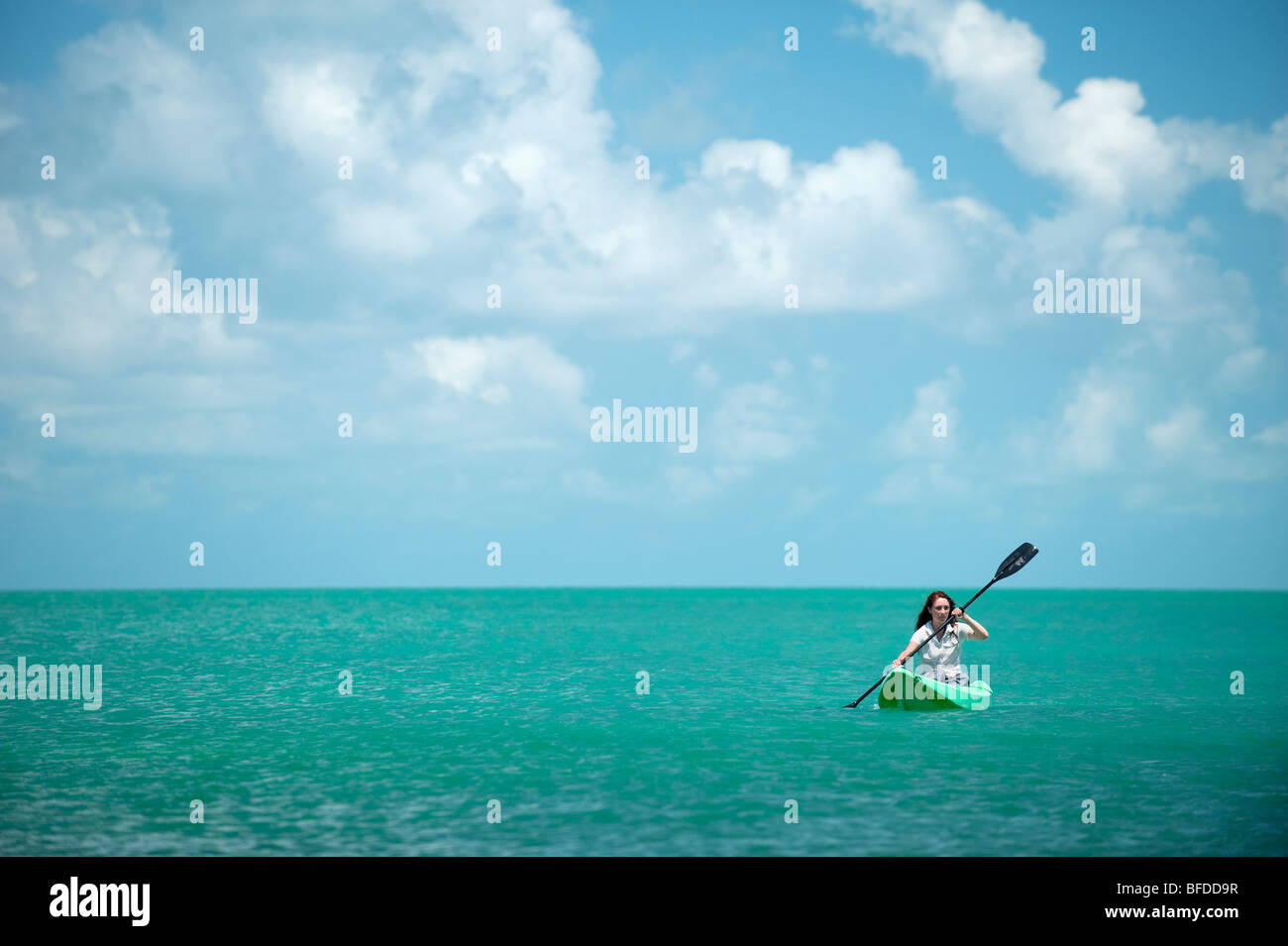 A woman kayaks in Florida. Stock Photo
