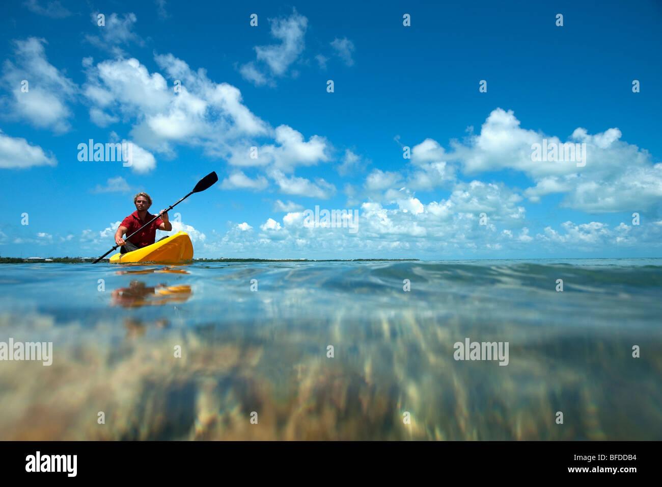 A man kayaks in Florida. - Stock Image