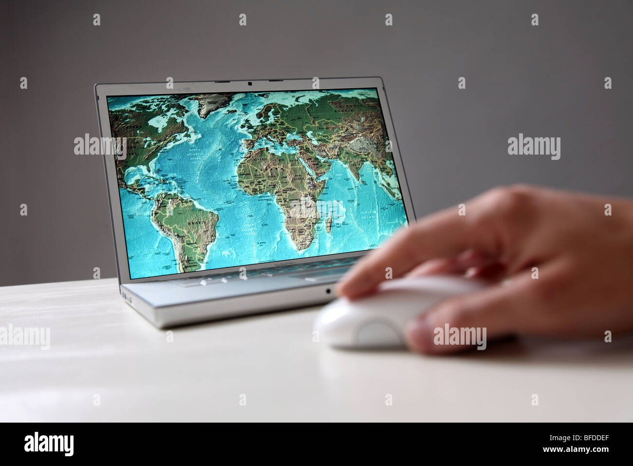 World map on computer screen - Stock Image