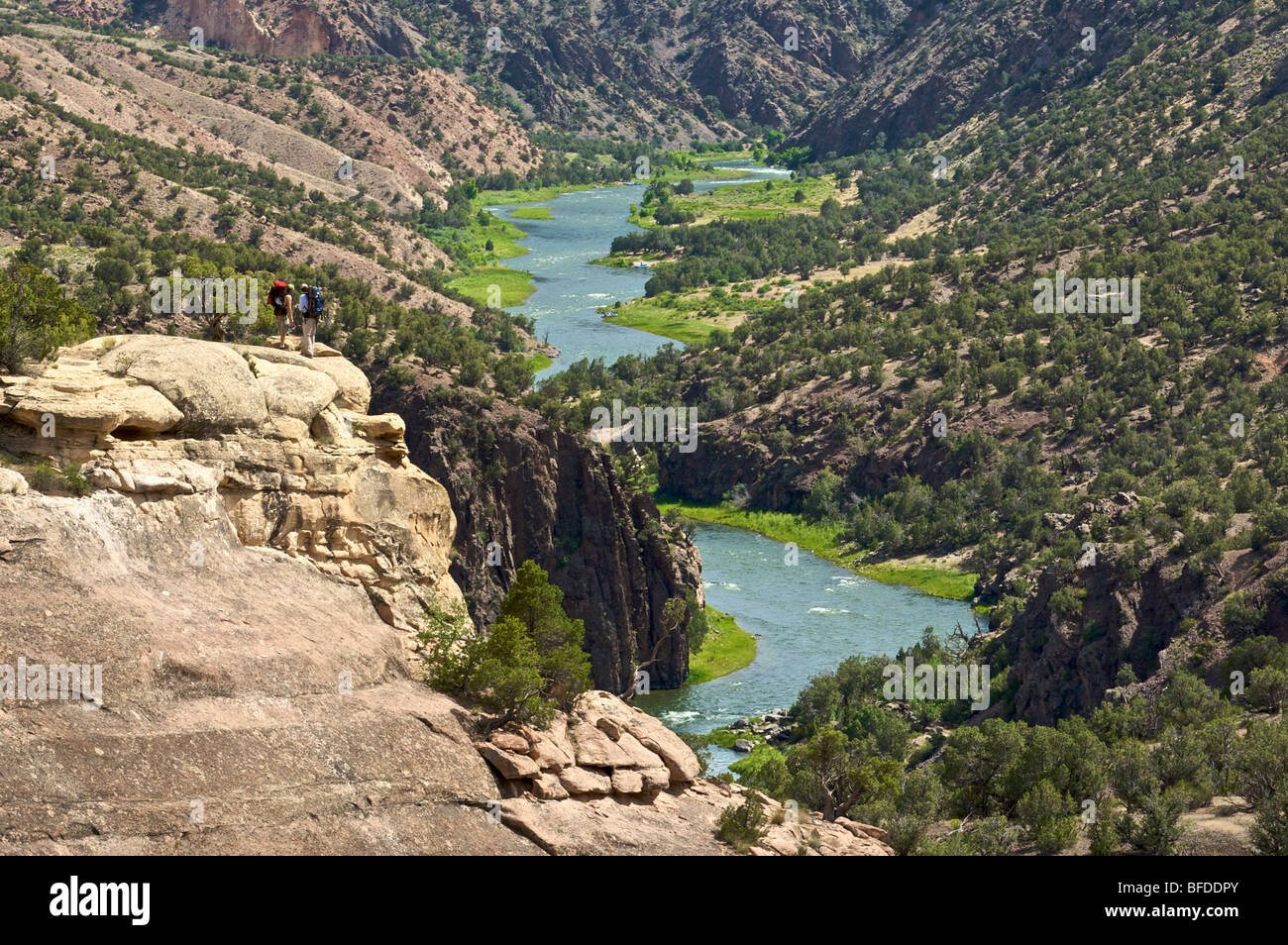 Two men look out over a gorge in Colorado. - Stock Image