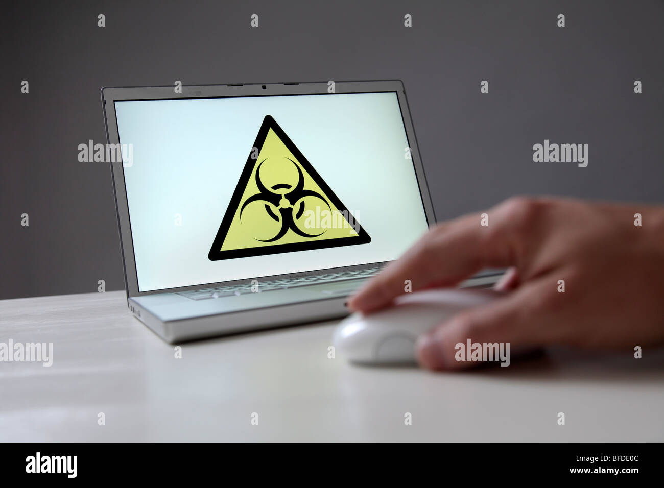 Biohazard sign on a computer screen. Symbol: computer virus, worm, etc - Stock Image