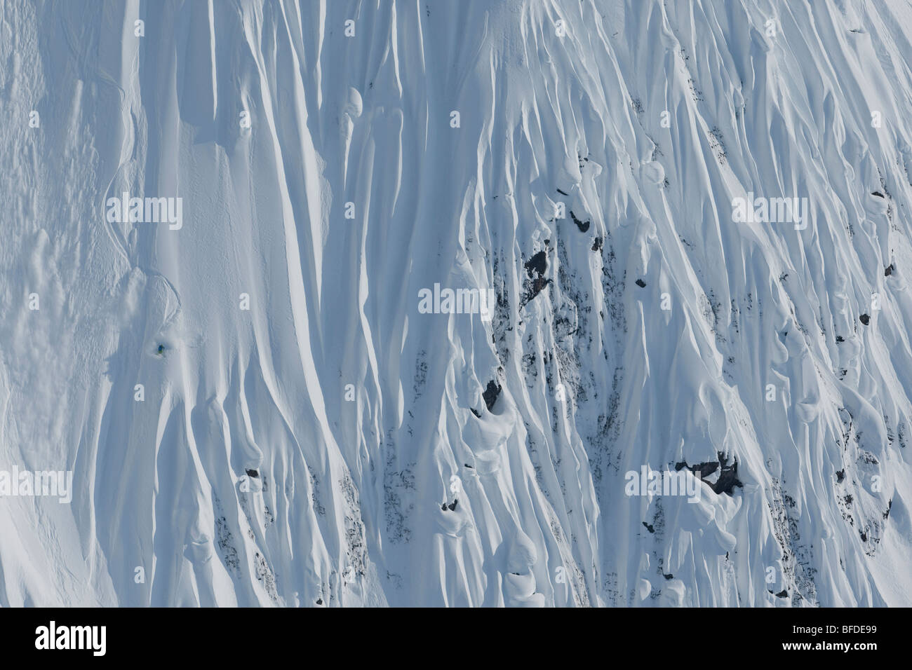 Skier making turns in steep terrain, Haines, Alaska. - Stock Image