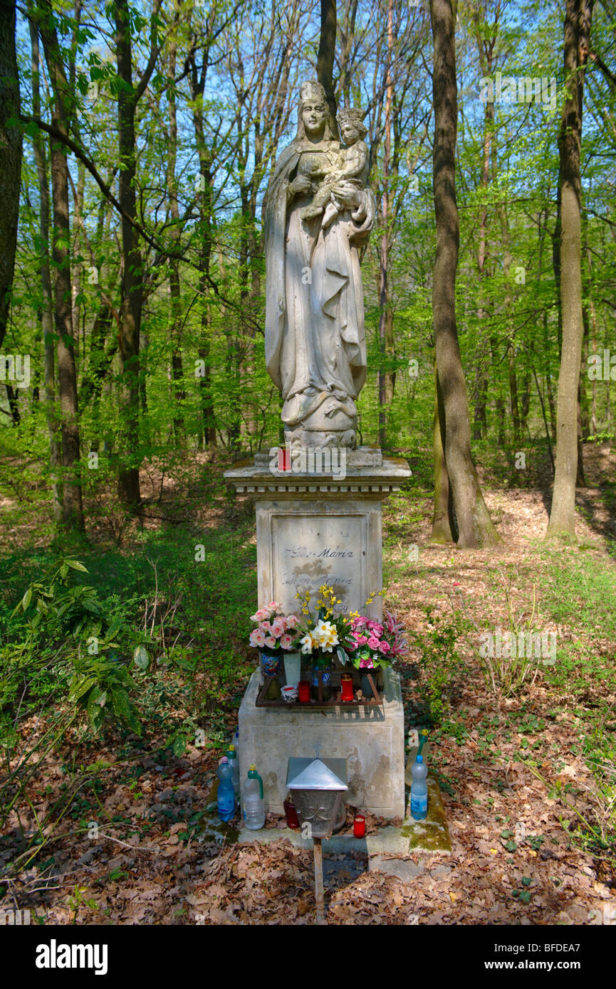 Religious staue of Mary in the forest near Koszeg, Hungary - Stock Image