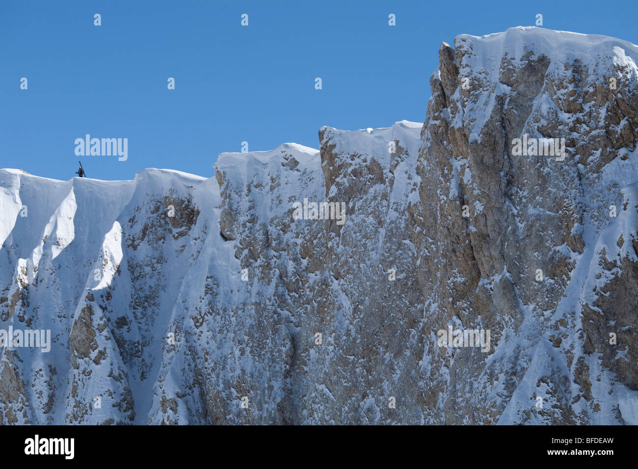 A lone skier hiking on an exposed ridge, Las Lenas, Argentina. - Stock Image