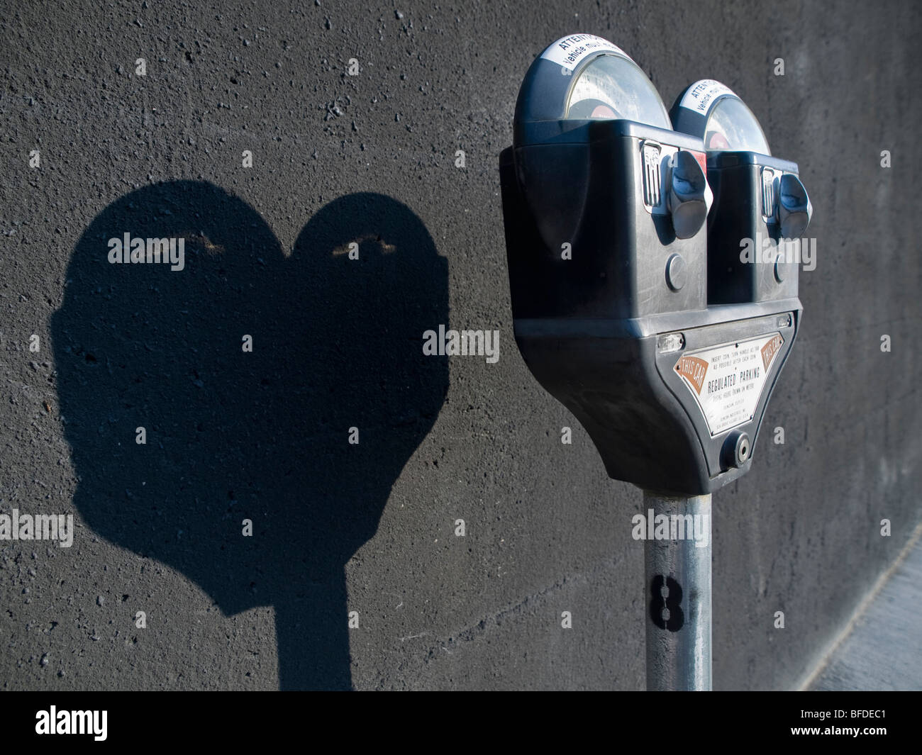 Parking meter and shadow. - Stock Image