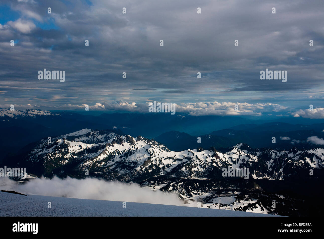A landscape image of snow capped Mount Rainier in the Cascades at dusk. - Stock Image