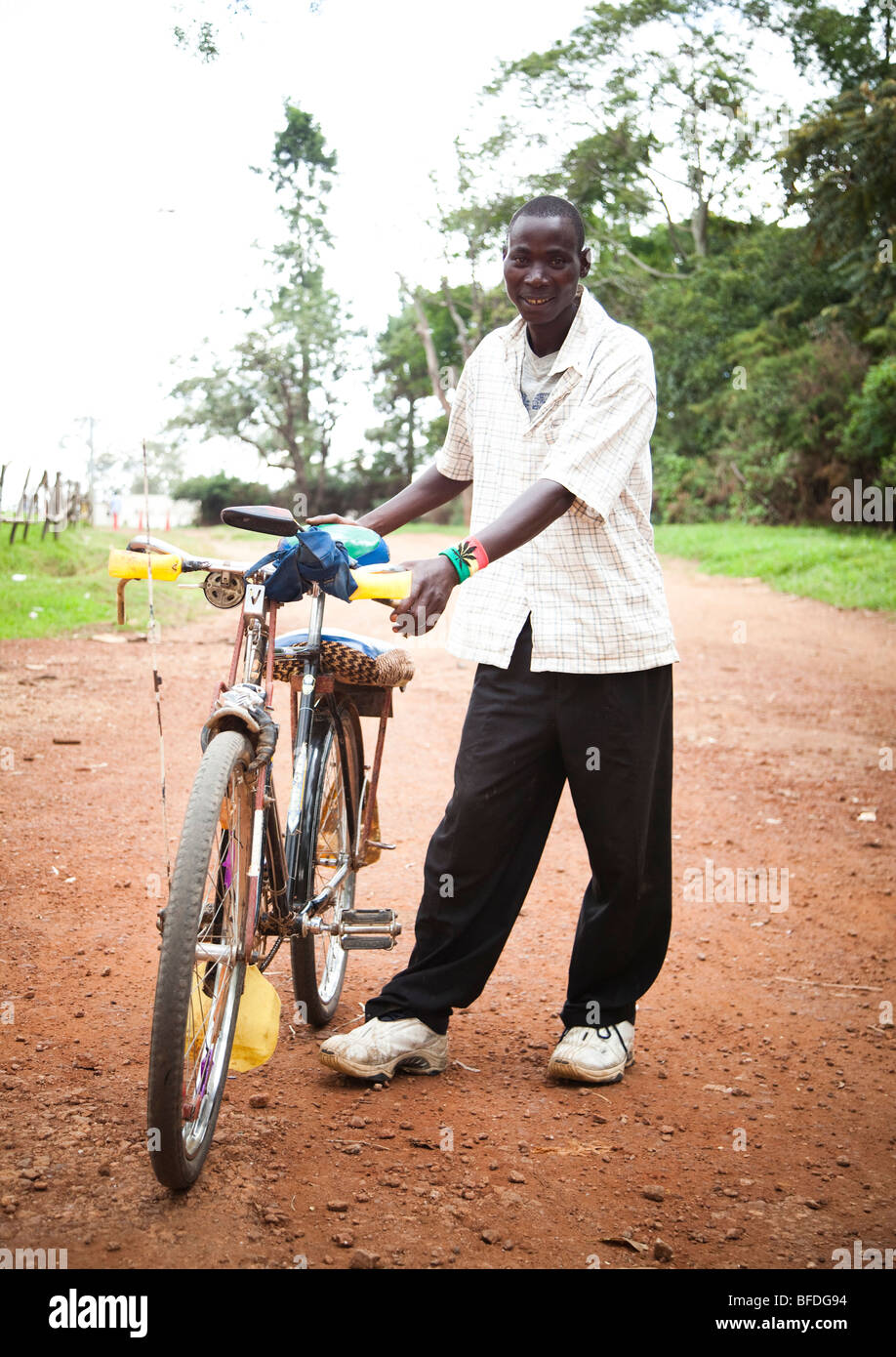 A taxi bicyclist shows off his bike in the city of Butare, Rwanda. Stock Photo