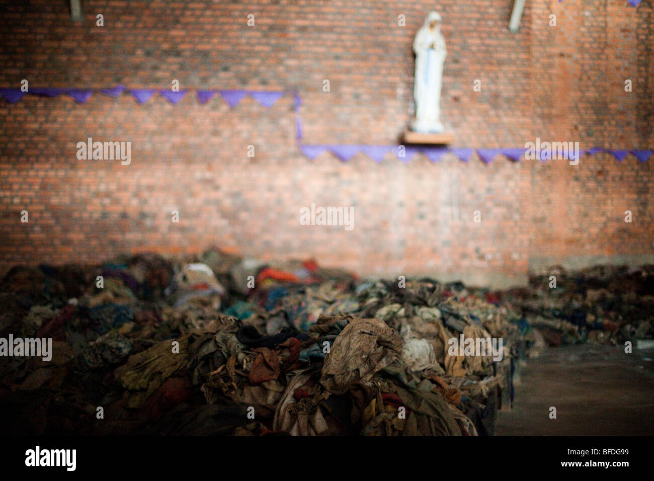 Clothes are piled high where thousands lost their lives at a church in rural Rwanda during the 1994 genocide. - Stock Image