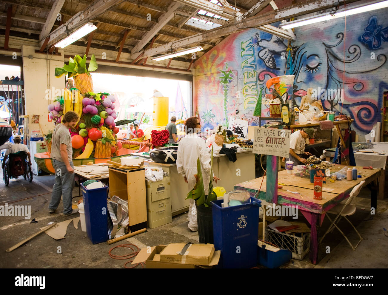 Volunteers at the workshop for a parade in Santa Barbara. The parade features extravagant floats and costumes. - Stock Image