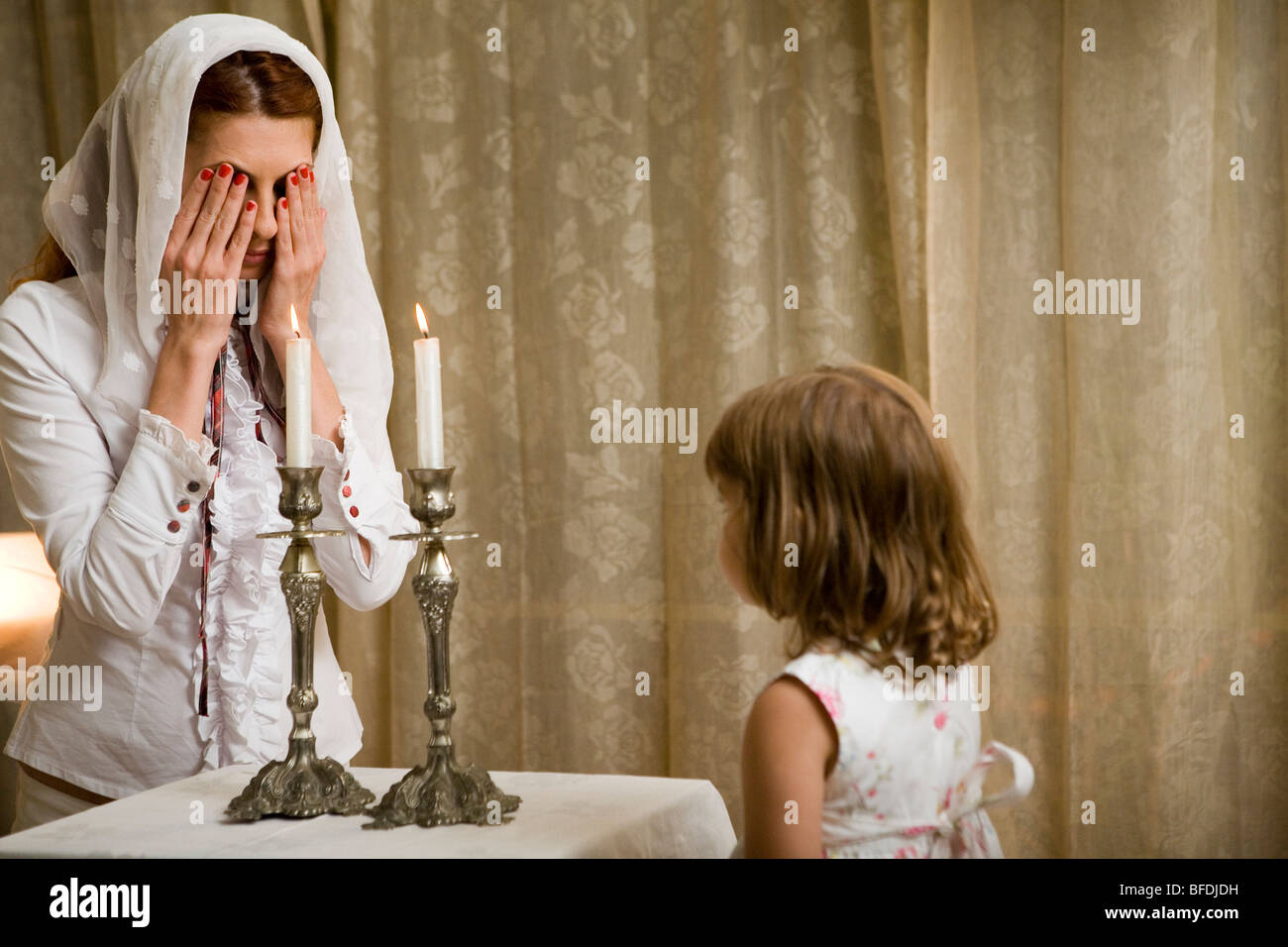 Mother and daughter lighting Shabbat candles. & Mother and daughter lighting Shabbat candles Stock Photo: 26730077 ...