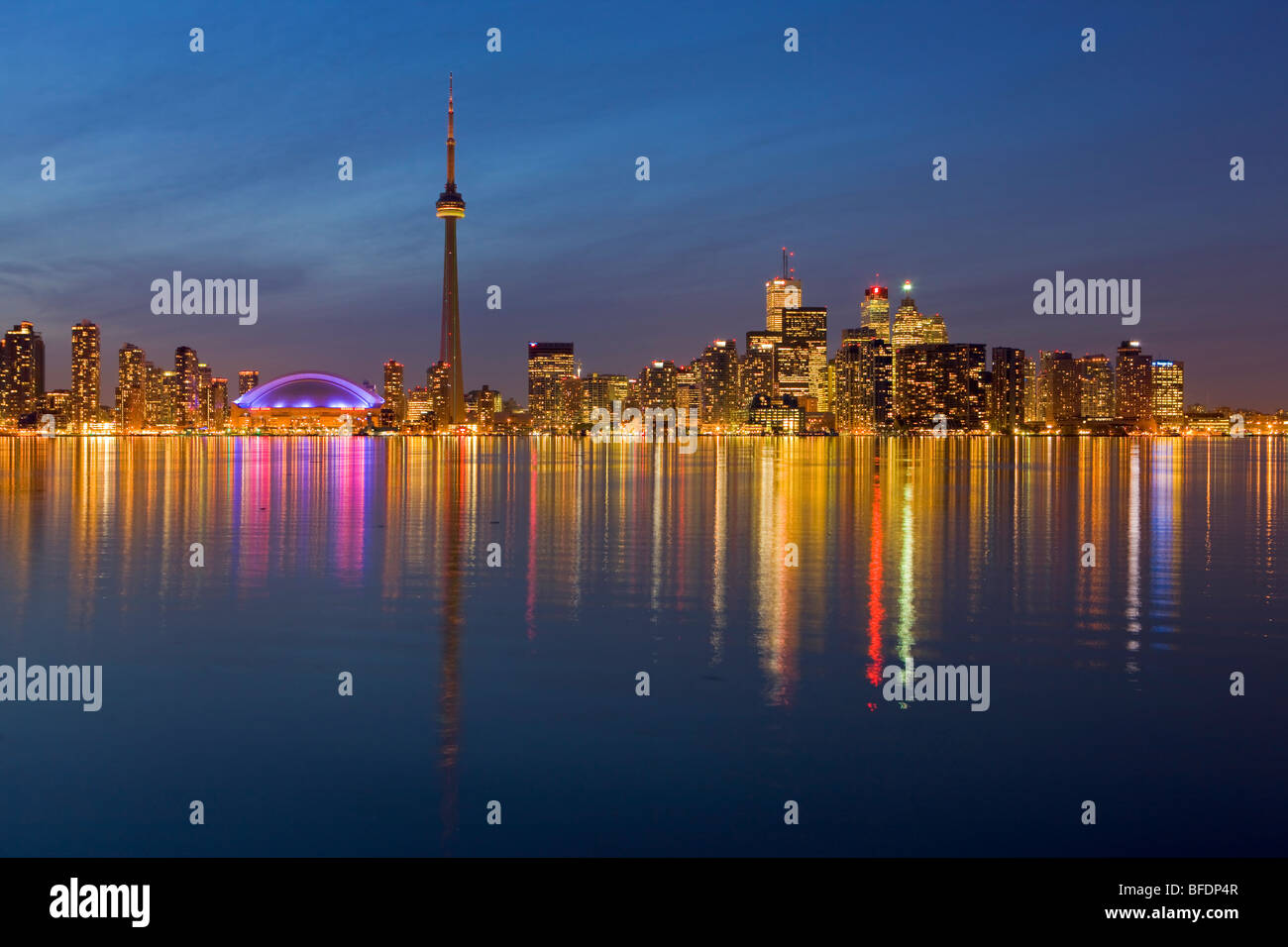 Toronto city skyline seen at dusk from Centre Island, Toronto Islands, Lake Ontario, Ontario, Canada Stock Photo