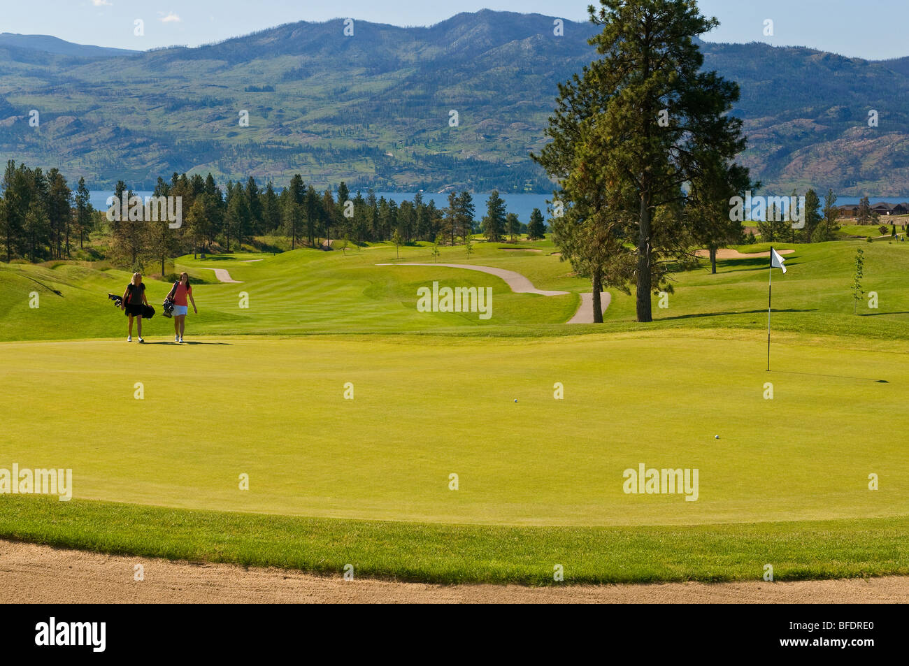 Two young women en route to the green at Two Eagles Golf Course in Westbank, British Columbia, Canada Stock Photo