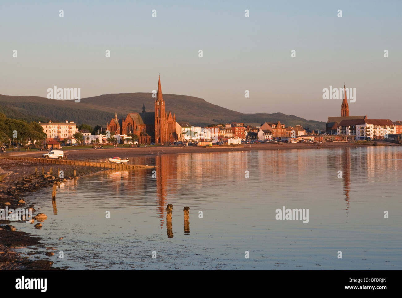 Evening view with warm light over the promonade at Largs - Stock Image