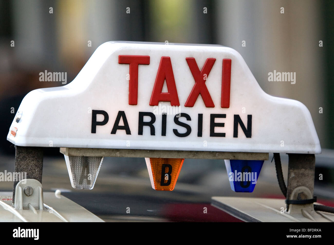 Sign atop a taxicab in Paris, France. - Stock Image