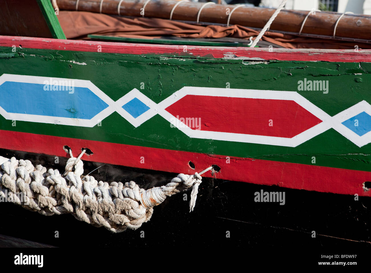 Detail of an historic fishing boat with painted decorations. Chioggia, Veneto, Italy - Stock Image