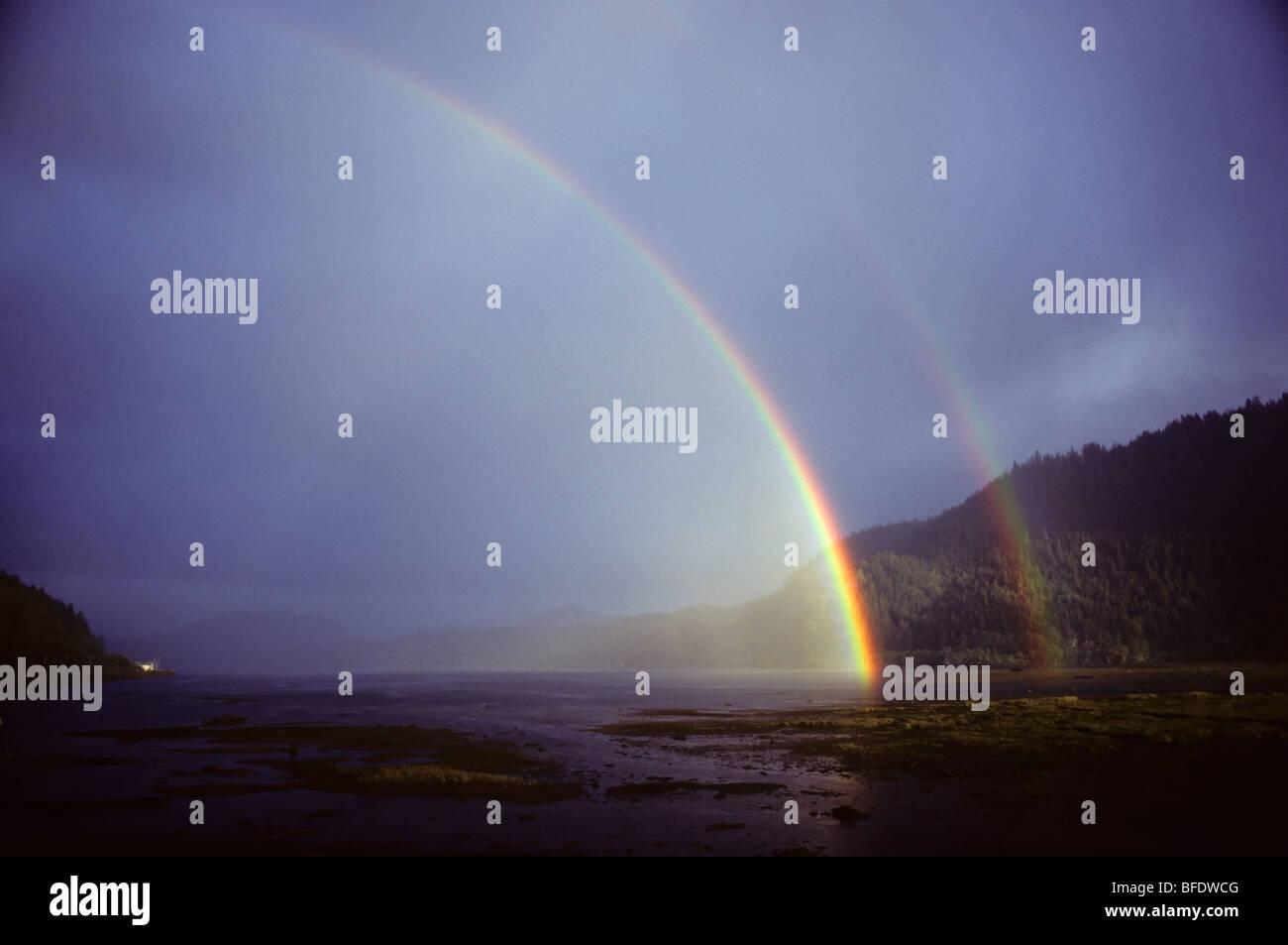 Double rainbow over the coast of Holberg, Vancouver Island, British Columbia, Canada - Stock Image