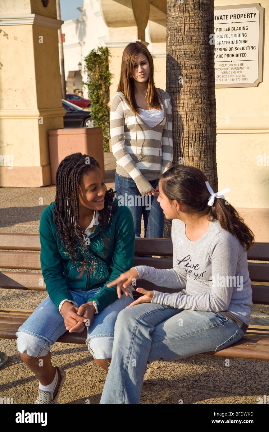 Hang hanging out Diverse group 13-15 year years old Teenage girls talking one sad girl feels left out  California - Stock Image