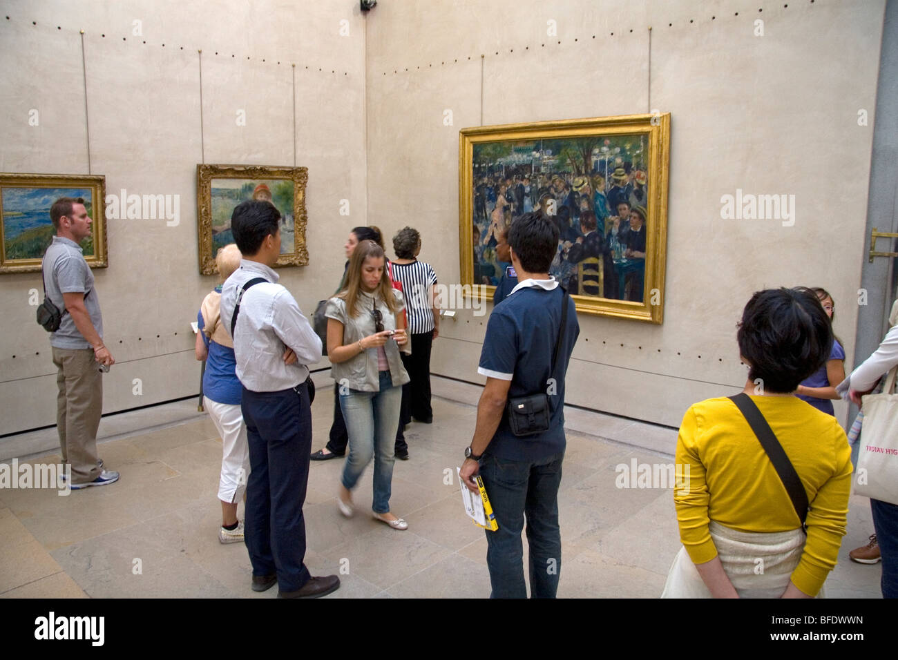 Visitors view artwork displayed in the Musee d'Orsay, Paris, France. - Stock Image