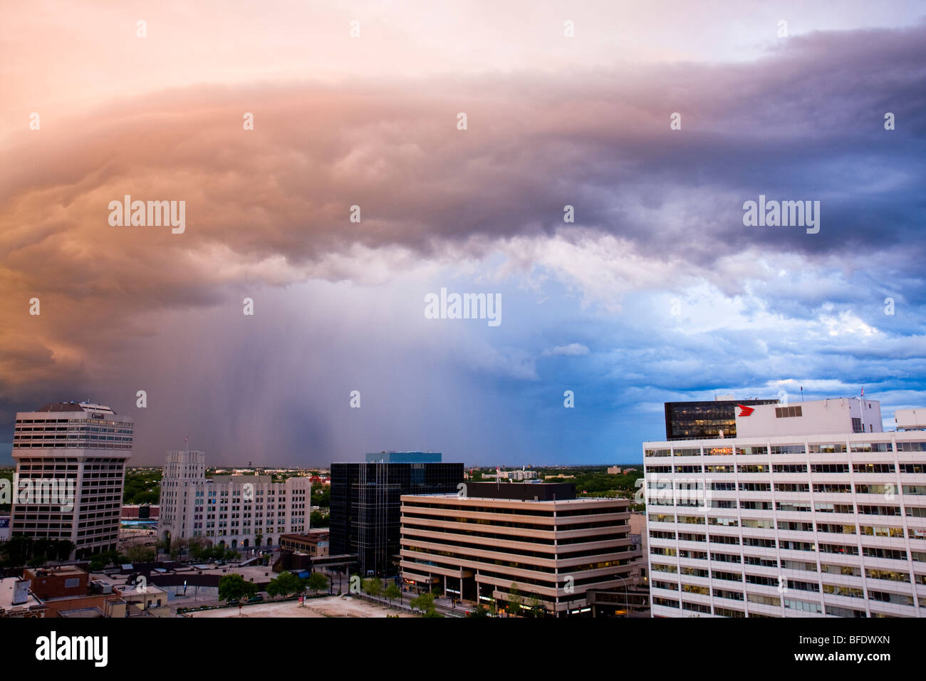 Colorful cloud formation at sunset over city of Winnipeg in Manitoba, Canada - Stock Image