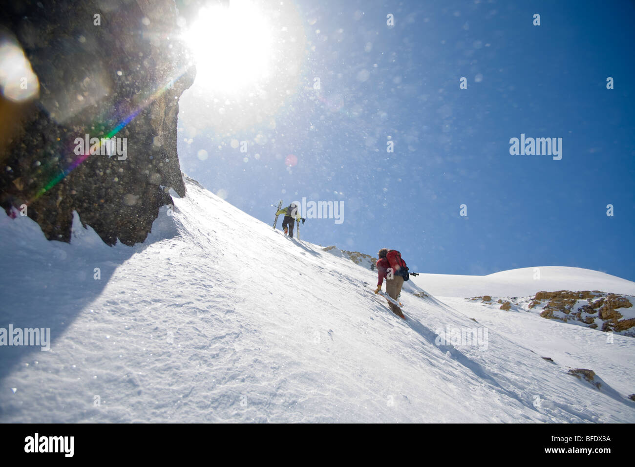 Skiers making their way up the White Pyramid, Mt Chephren, Icefields Parkway, Banff National Park, Alberta, Canada - Stock Image