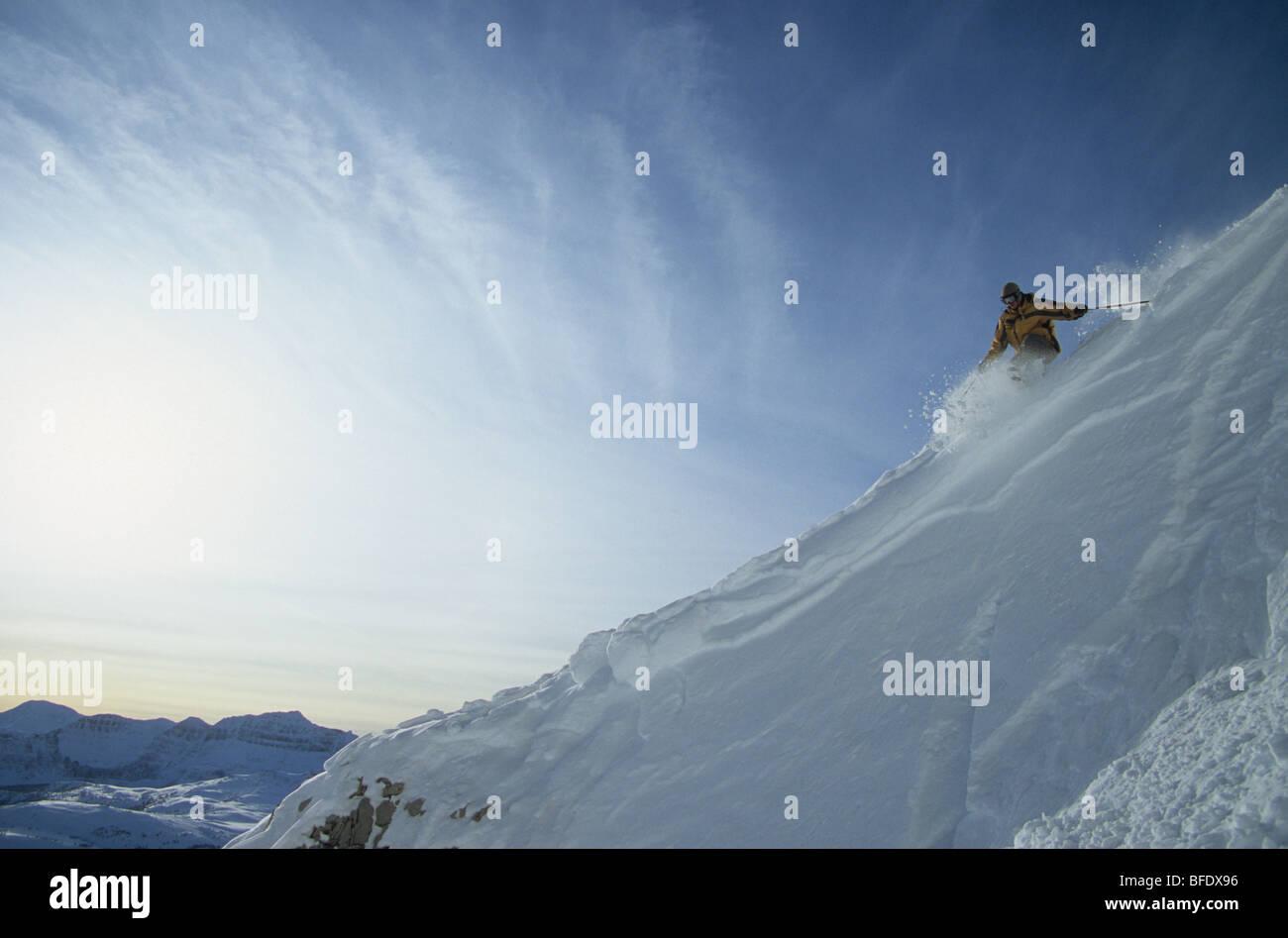 A skier making some powder turns at Sunshine Village, Banff National Park, Alberta, Canada - Stock Image