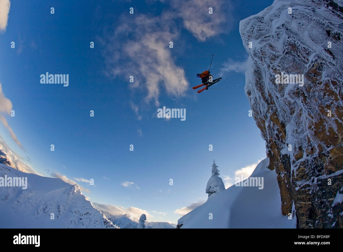 A skier catching big air in the backcountry of Kicking Horse, Golden, British Columbia, Canada - Stock Image
