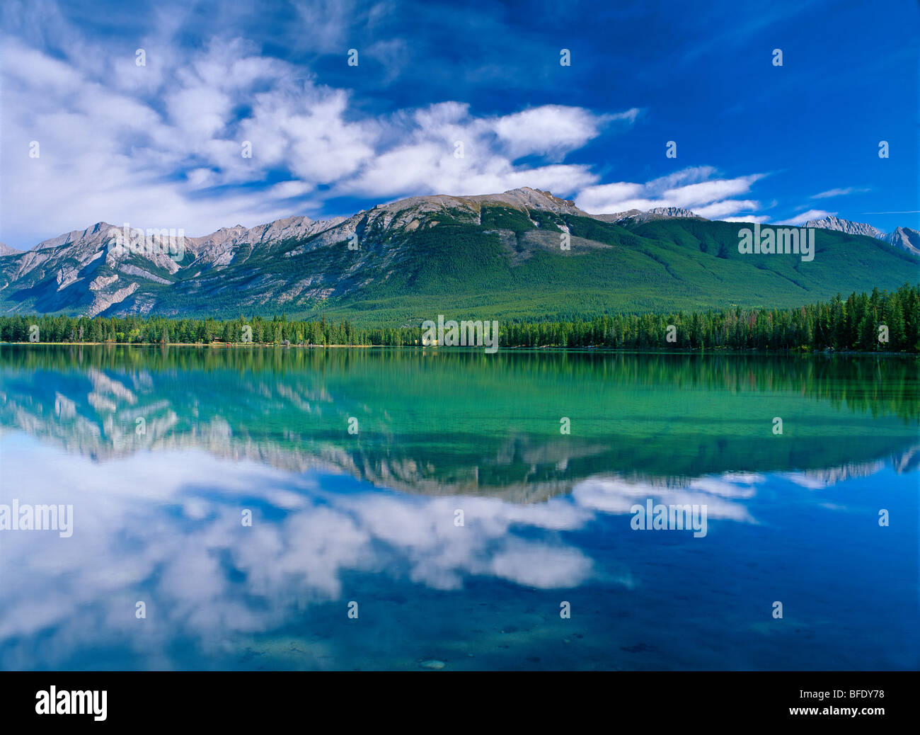 Clouds reflected in Lake Annette, Roche Bonhomme and the Colin Range in the background, Jasper National Park, Alberta, - Stock Image