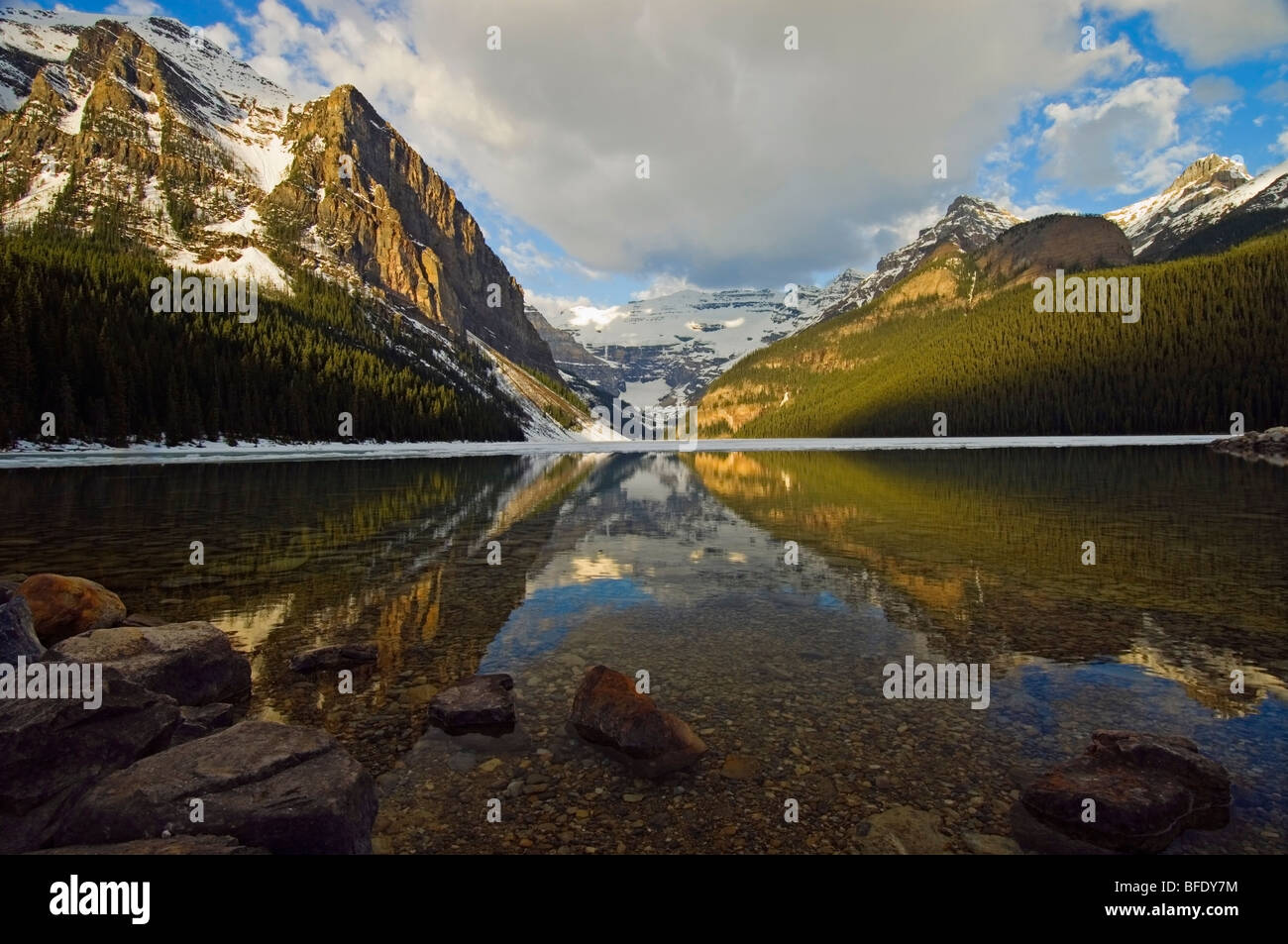 Water reflections in Lake Louise, Banff National Park, Alberta, Canada - Stock Image