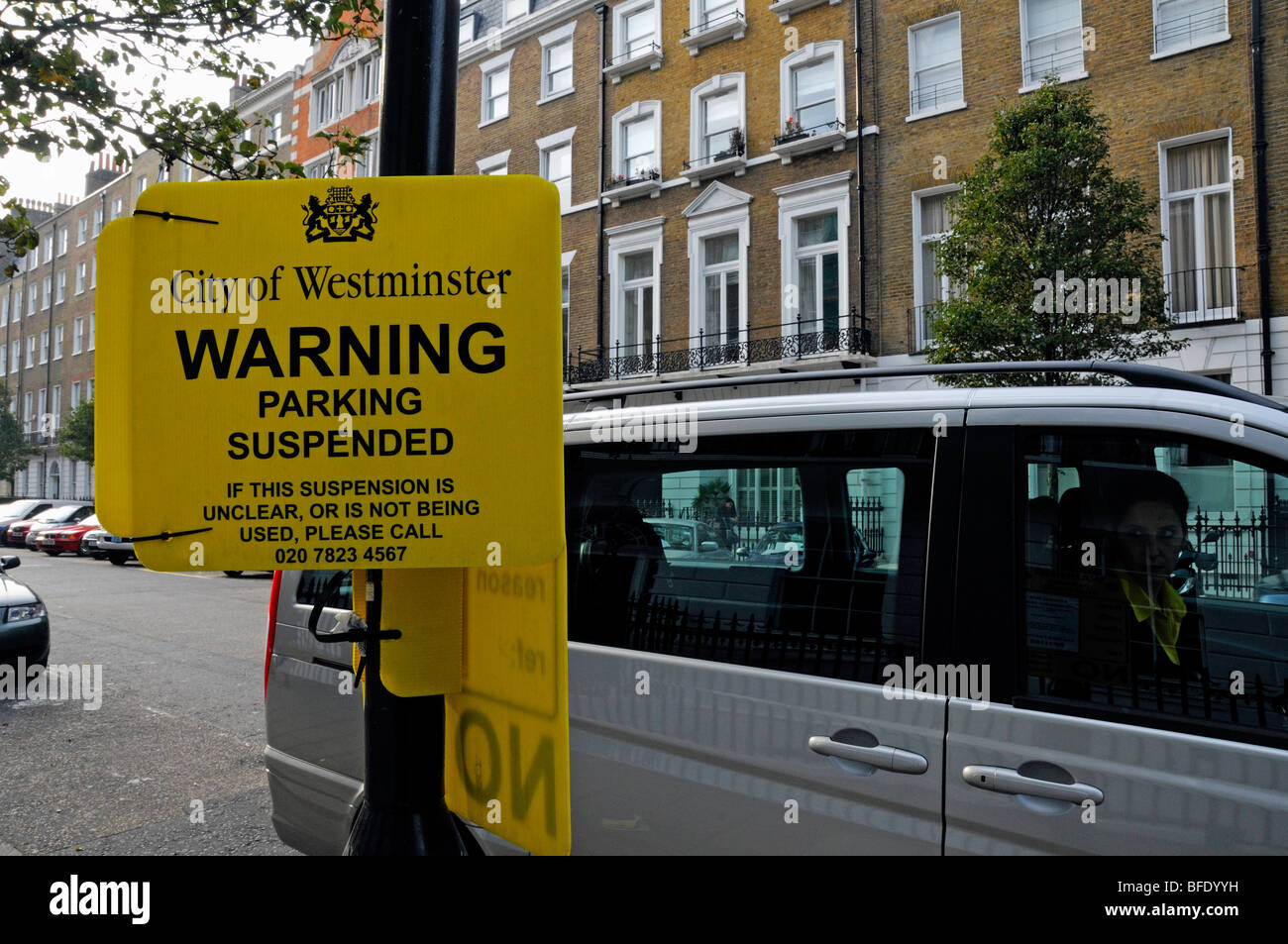 Suspended Parking bay sign with parked car, Westminister London England UK - Stock Image