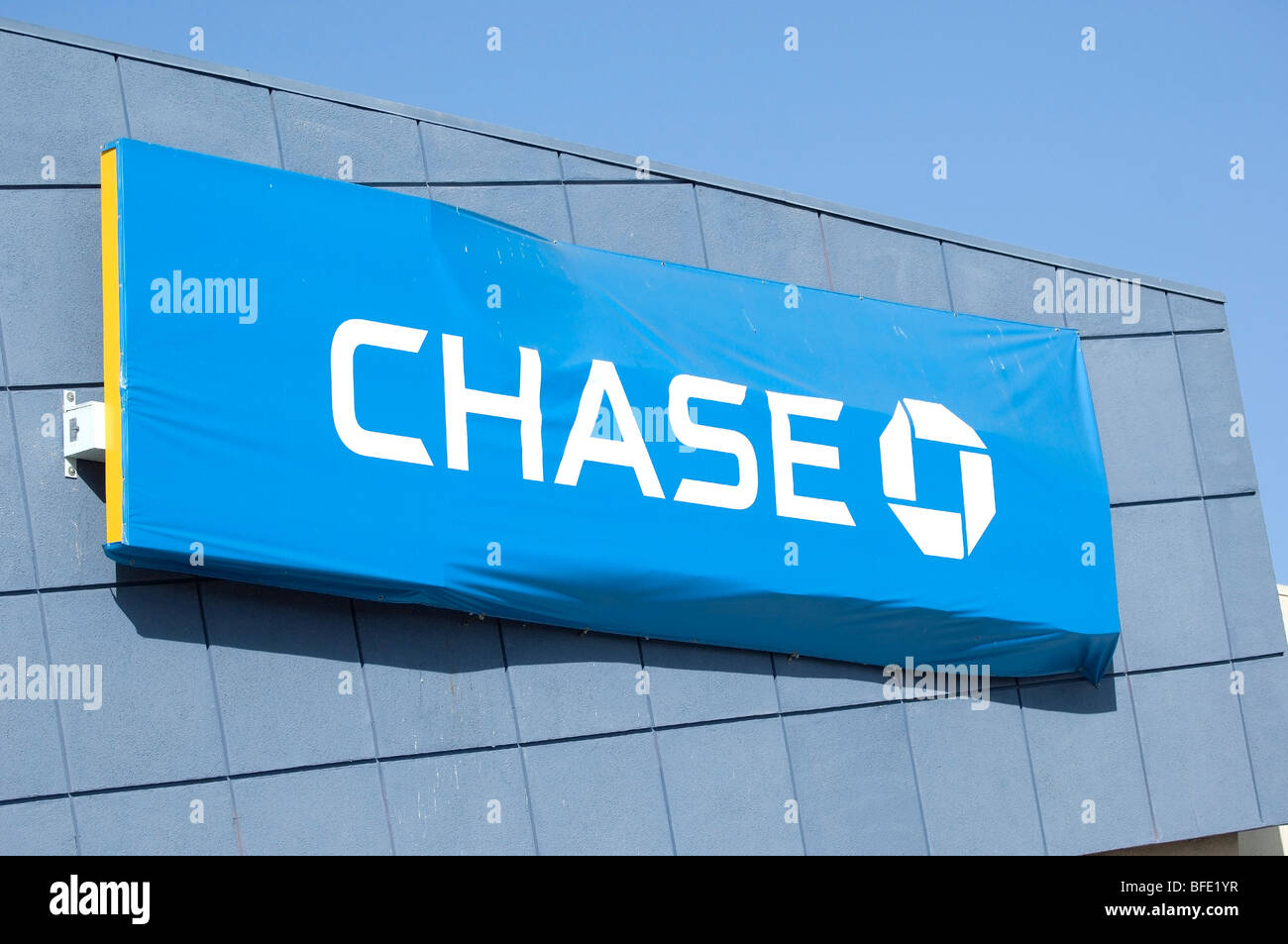 Banners cover up the former Washington Mutual Bank sign when Chase Bank replaced it. - Stock Image
