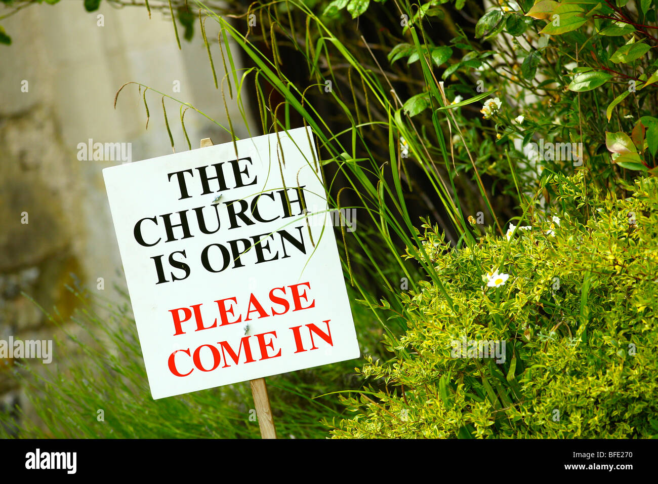 Open sign outside a church - Stock Image