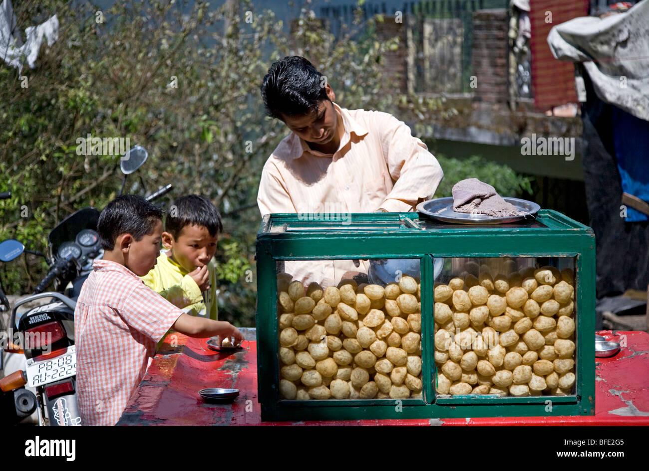 Kids eating pani puri (traditional snack). Kangra. Himachal Pradesh. India - Stock Image
