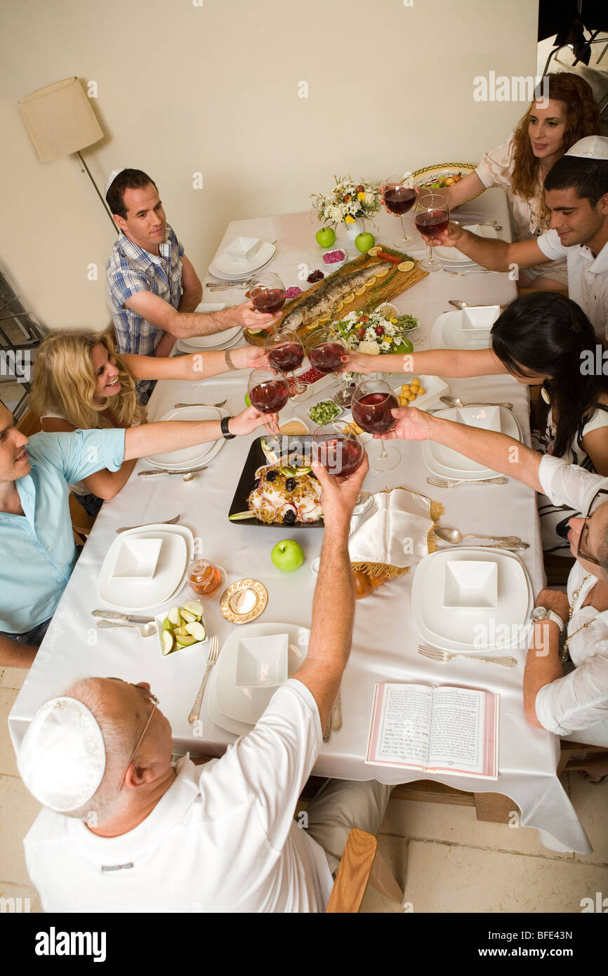 High angle view of a family at a festive dinner table. - Stock Image