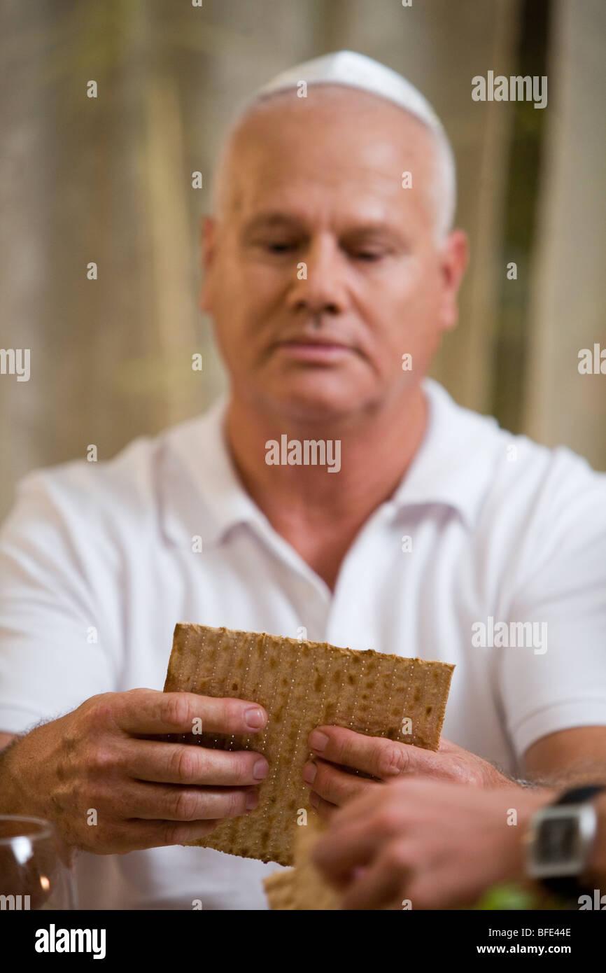 Braking the Matzah. - Stock Image