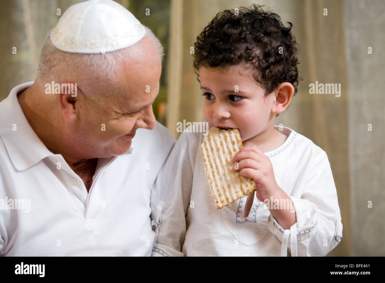 Child eating Matzah. - Stock Image