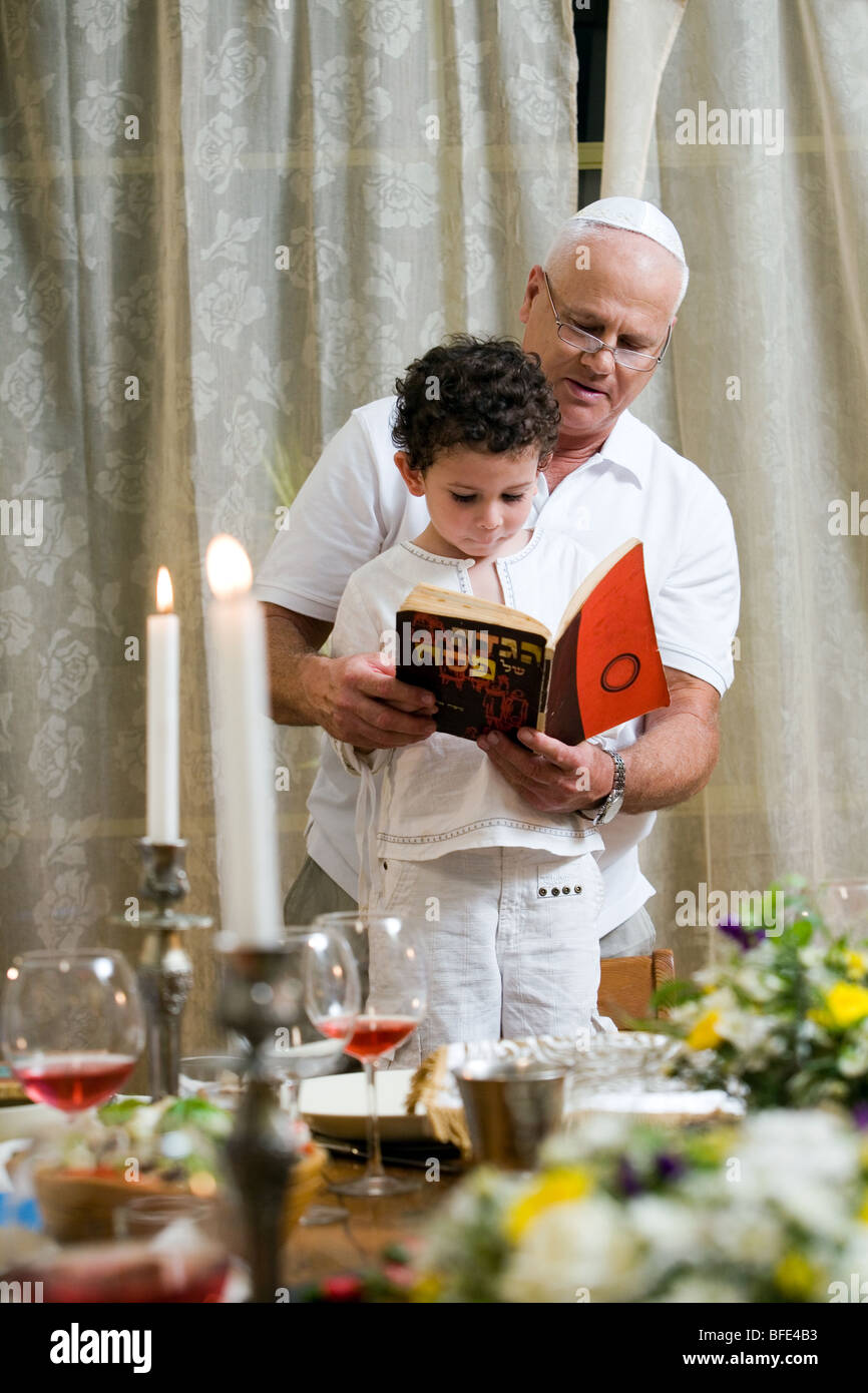 Boy reading 'Ma Nishtana' at Seder Night. - Stock Image