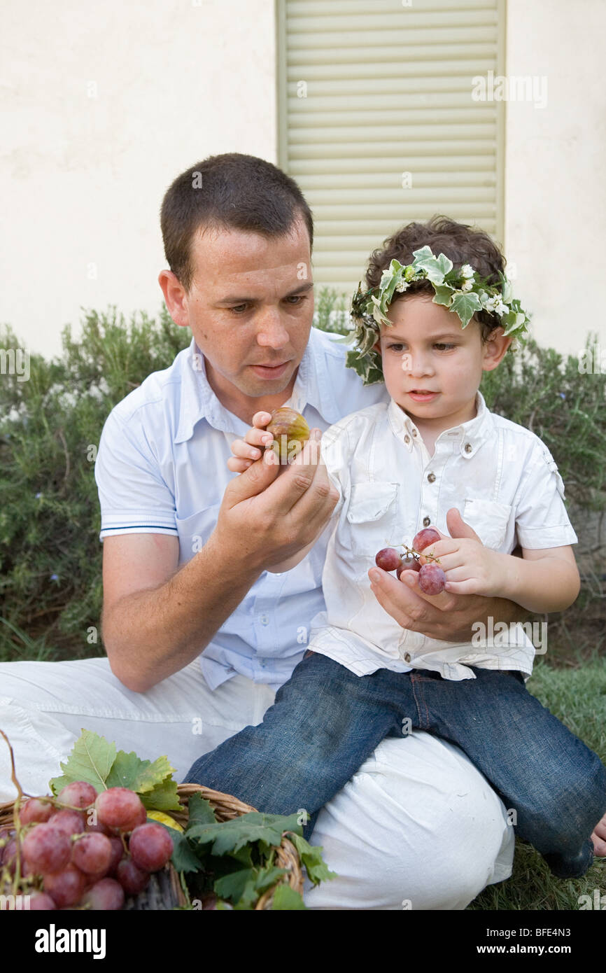 Celebrating Shavuot with first fruits. - Stock Image