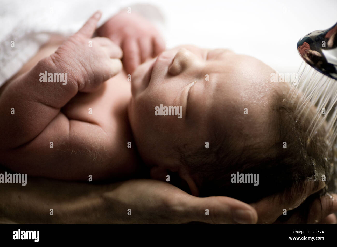 3 day old baby boy being washed for the first time in the sink at the hospital, Chateauguay, Quebec, Canada - Stock Image