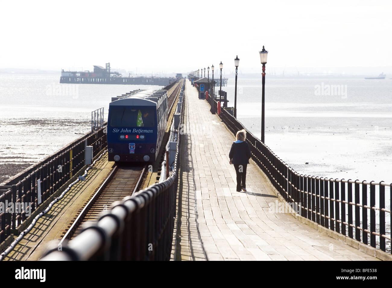Southend Pier - the worlds longest pleasure pier, the Sir John Betjeman train sets off on the 1.33 mile journey. - Stock Image