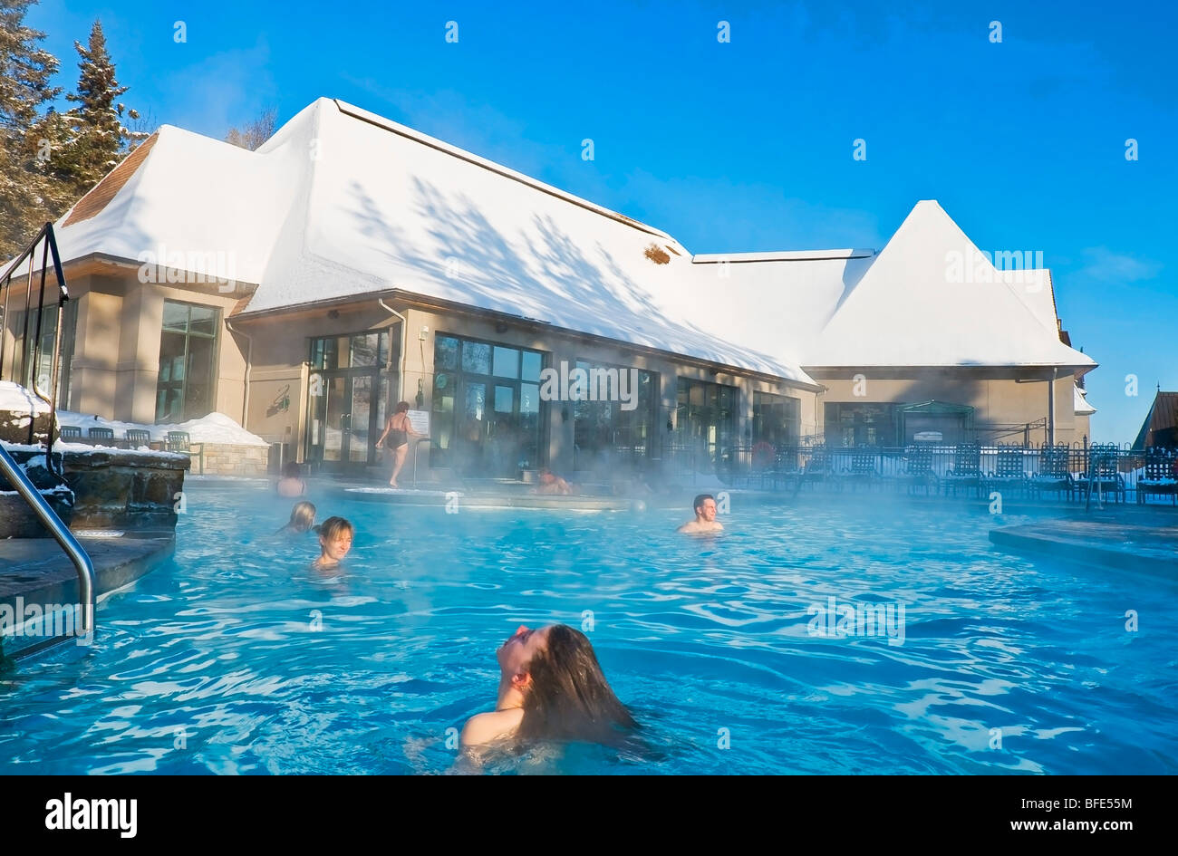 People Bathing In A Heated Swimming Pool In Winter At Fairmont Manoir  Richelieu Hotel, La Malbaie, Charlevoix, Quebec, Canada