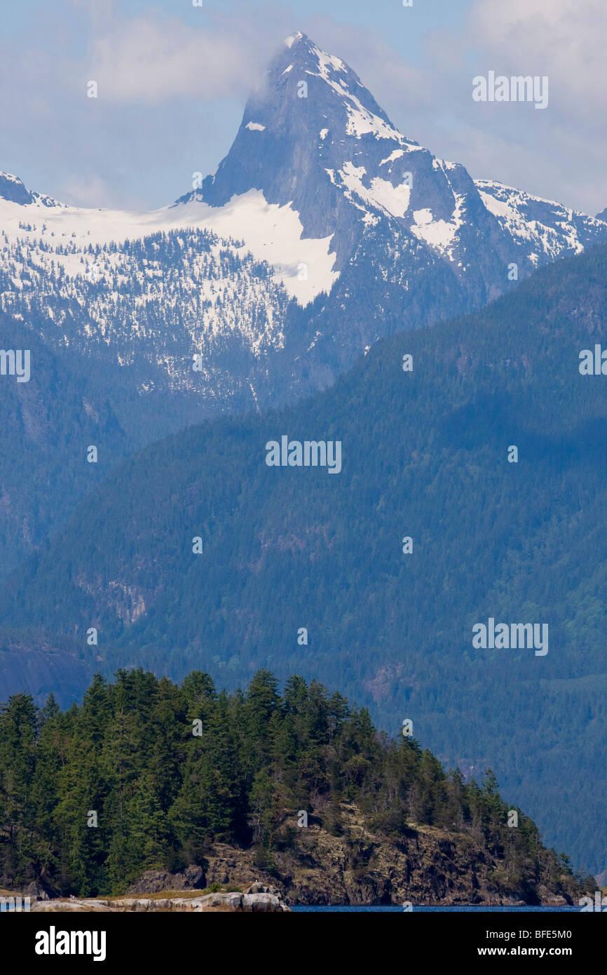 Mount Denman in the Coast Range looms, Desolation Sound, British Columbia, Canada - Stock Image