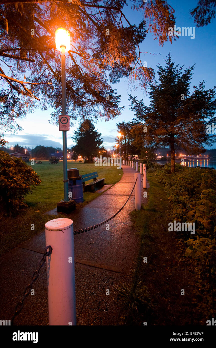 Seawalk, Port Hardy is bathed in light from a lamppost, Port Hardy, Vancouver Island, British Columbia, Canada - Stock Image