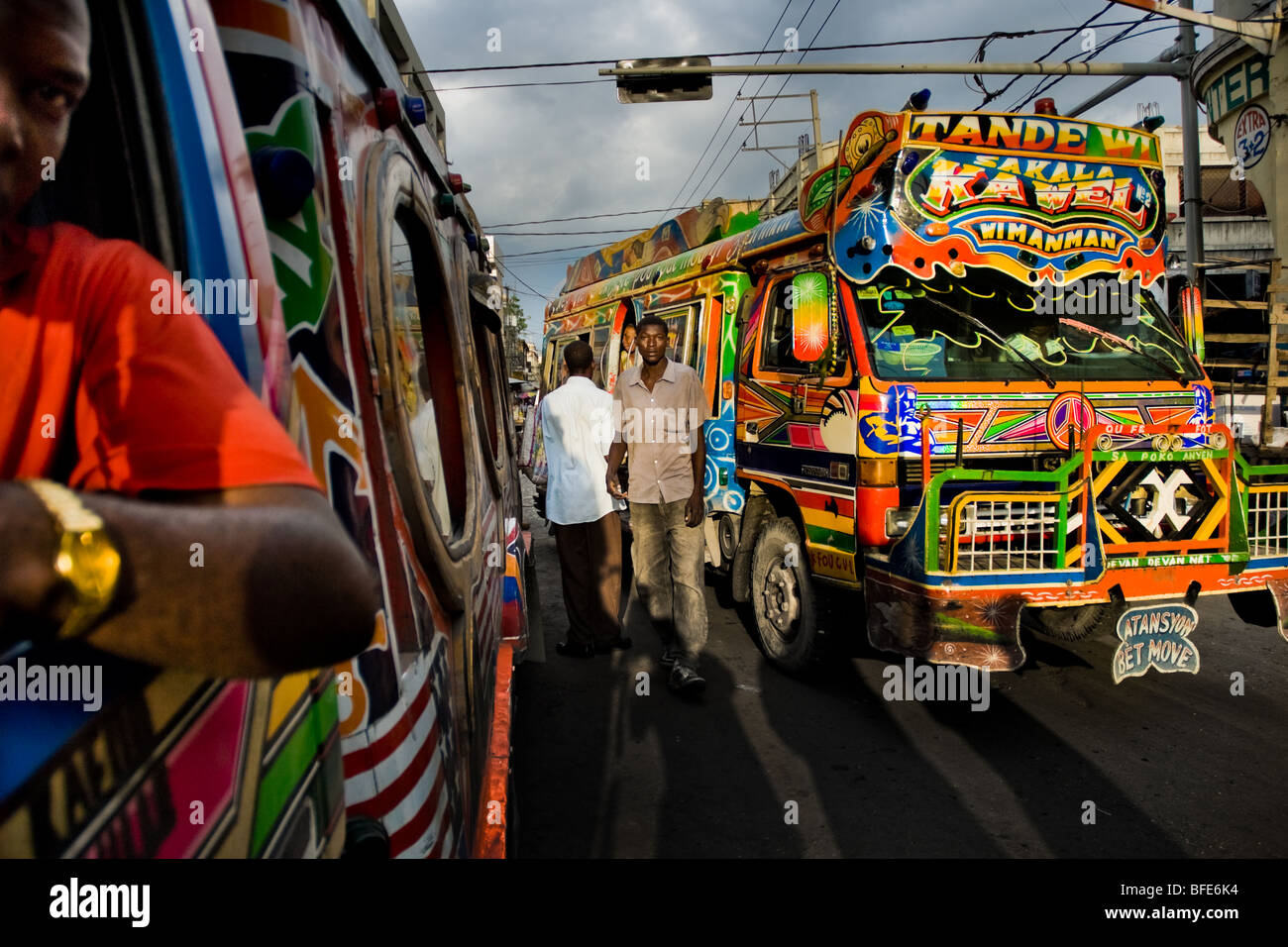 Tap-tap buses passing through the traffic chaos in the downtown of Port-au-Prince, Haiti. - Stock Image